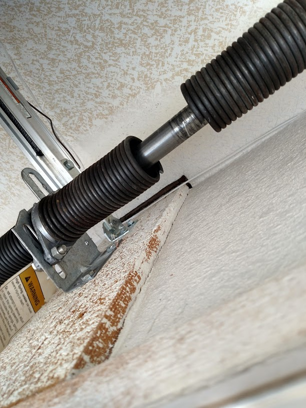repaired torsion spring